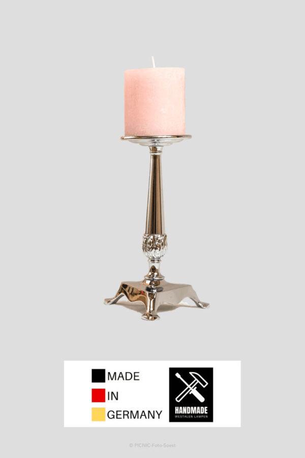 Chrom Kerzenständer mit rosa Stumpenkerze